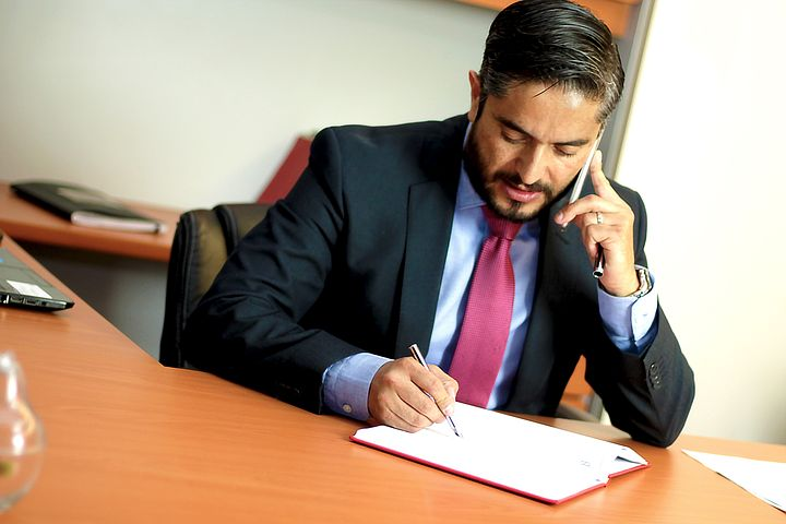 trusted will dispute lawyer talking to a client over the phone